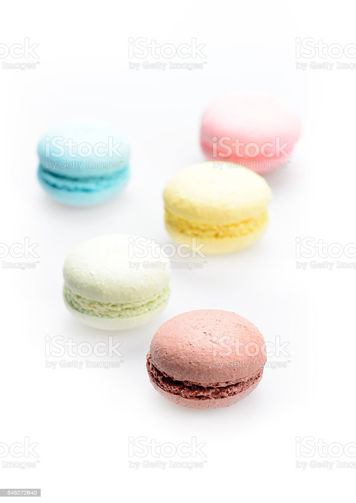 french colorful macarons on a white background stock photo