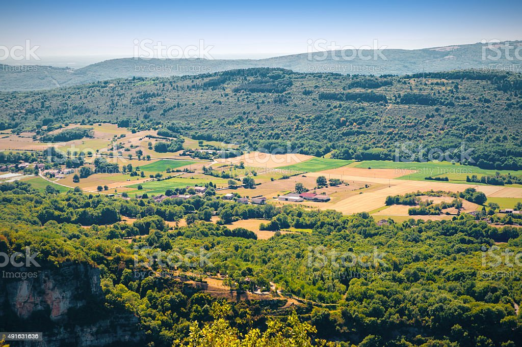 French countryside landscape aerial view with forest meadow and houses stock photo