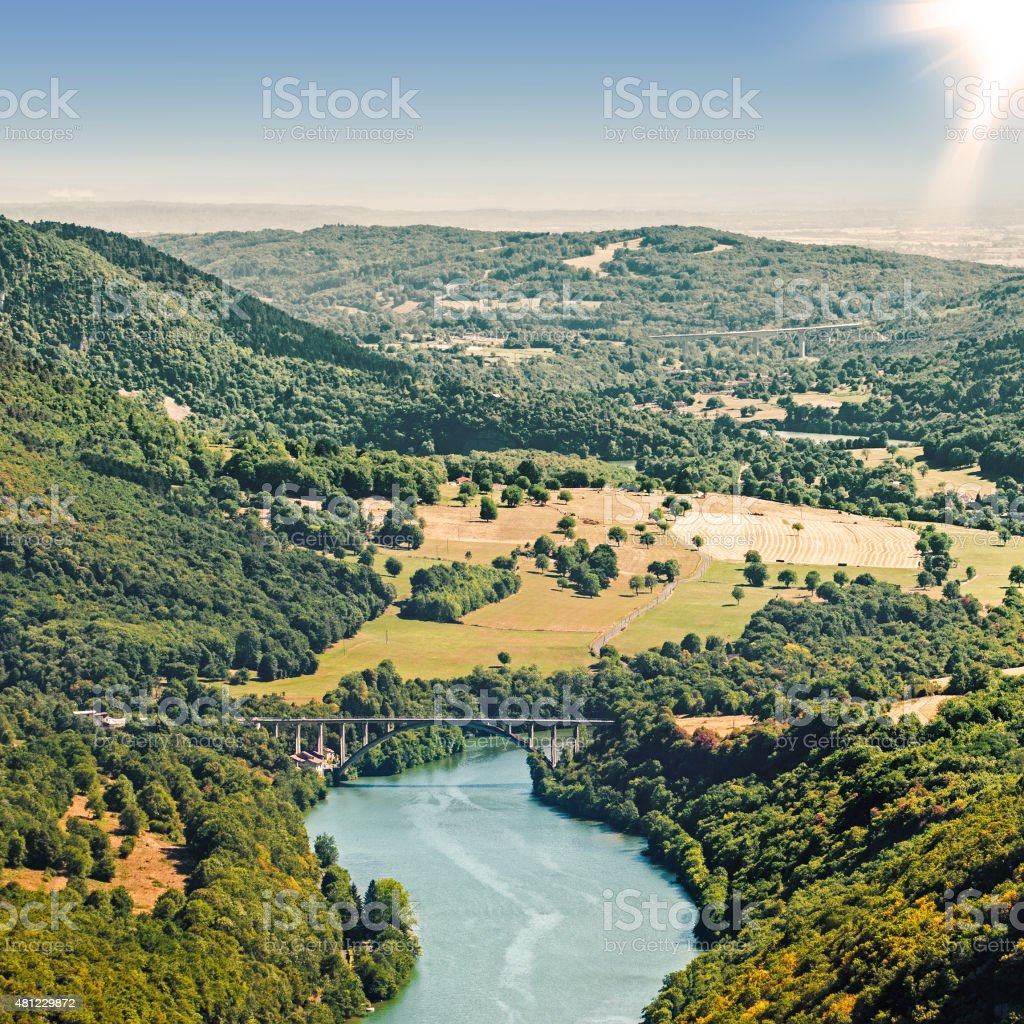 French countryside river aerial view in summer by bright sunset stock photo