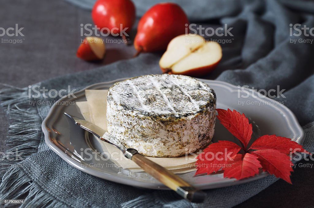 French cow's milk cheese and red pears stock photo