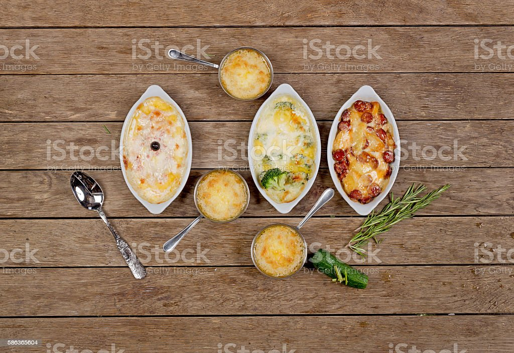 French cuisine. chicken with mushrooms baked  cheese in a cocotte stock photo