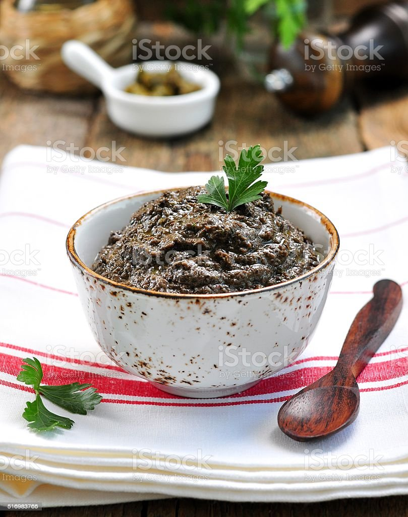 French cuisine, tapenade of olives, capers, anchovies and olive oil. stock photo