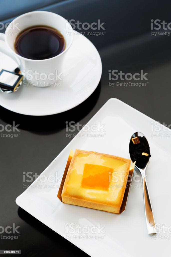 French custard with tea on table stock photo