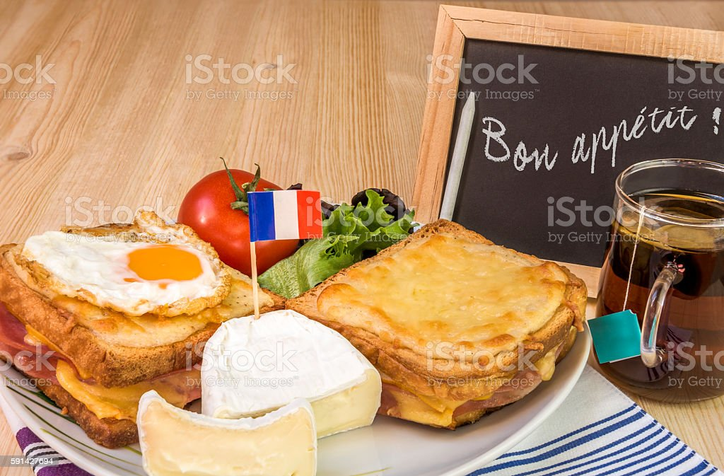 French dish with message on chalkboard stock photo