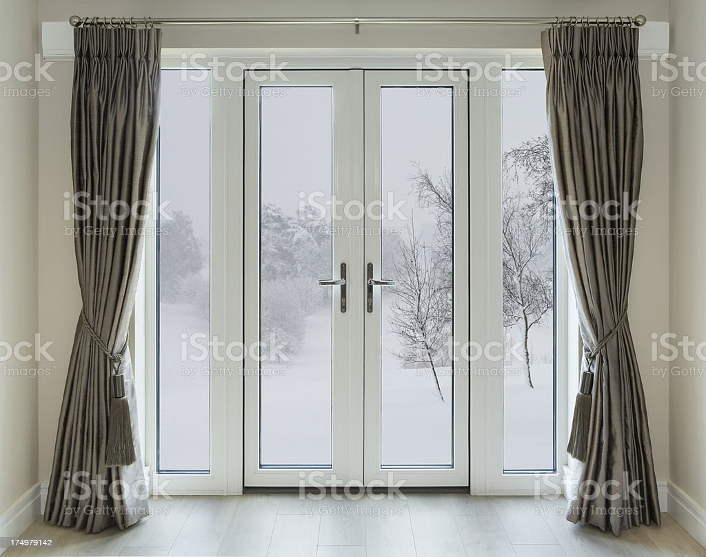 French doors with winter view stock photo