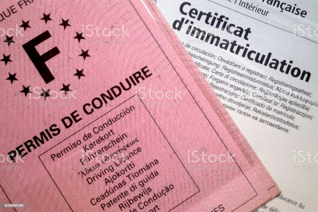 Close up on a permis de conduire and a carte grise . In order to...