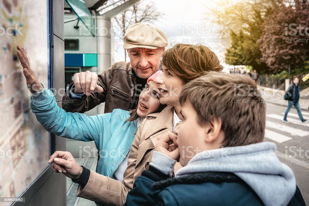 french family orientating at outdoor city map in Monmartre  Paris stock photo