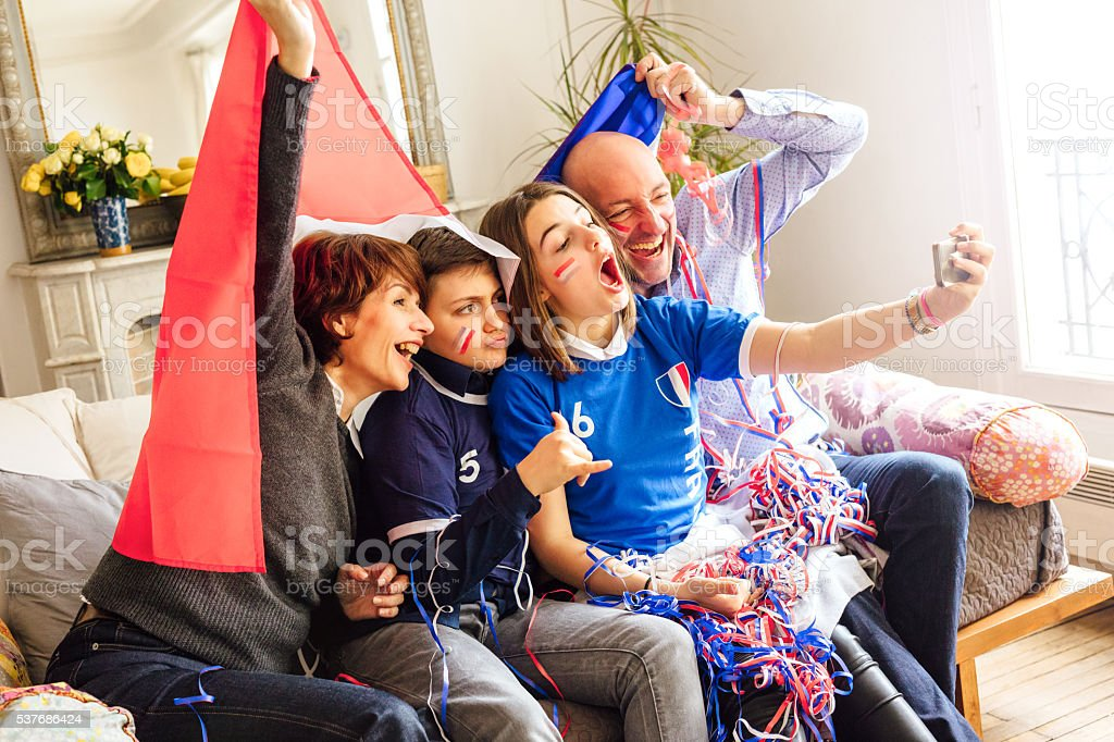 french family posing for fan selfie stock photo