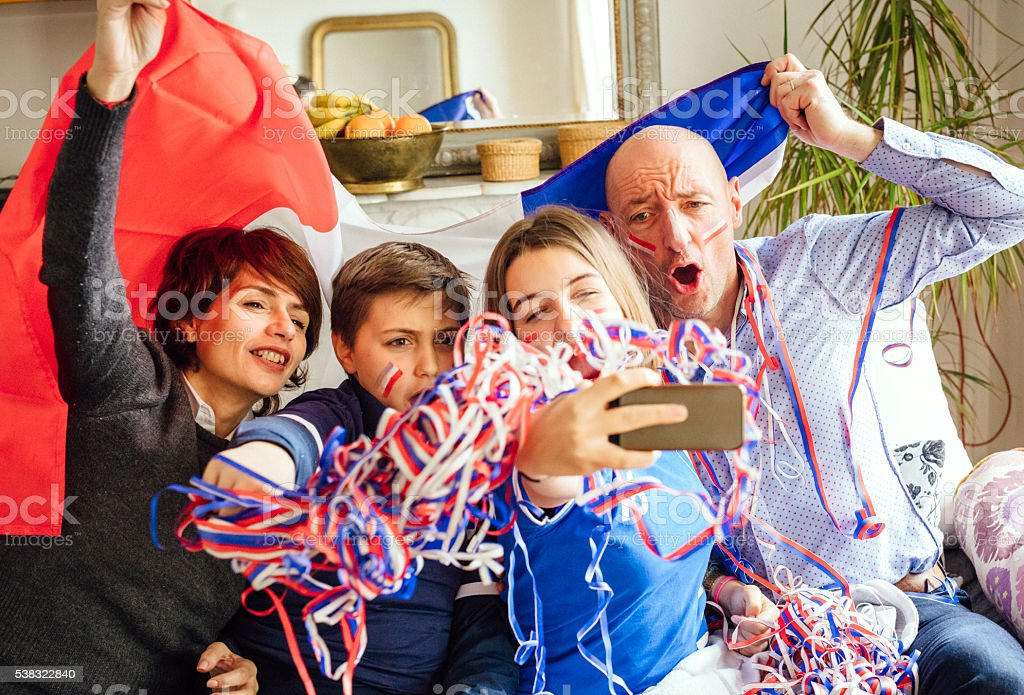french family posing for fan selfie stock photo