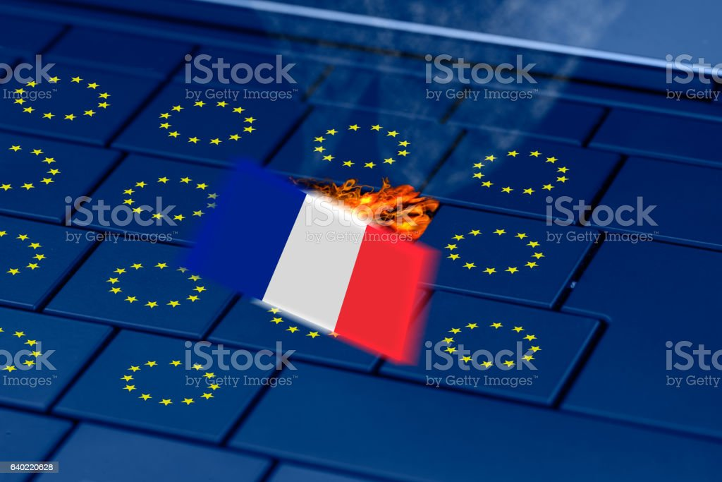 french flag exploding in a pc keyboard during french elections stock photo