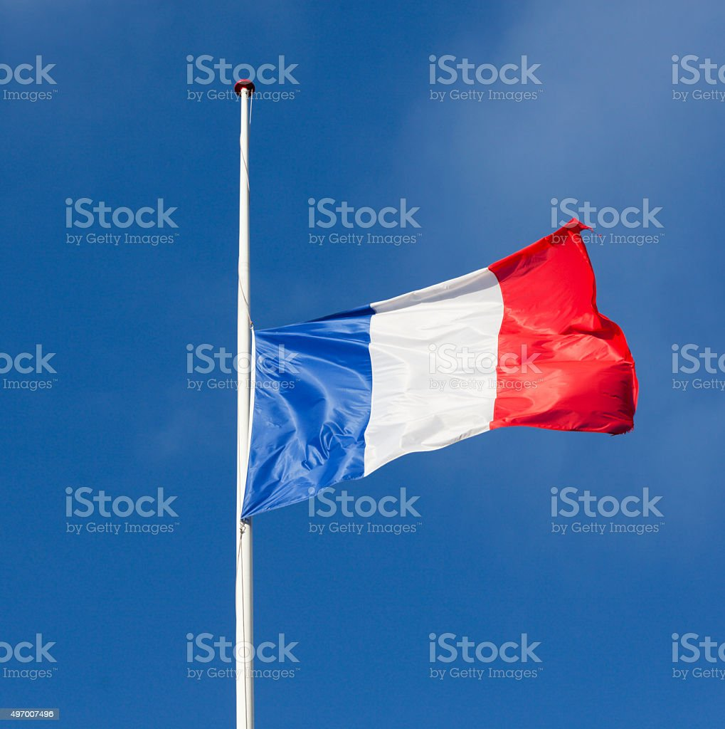 French flag half mast after terror attack in France. stock photo