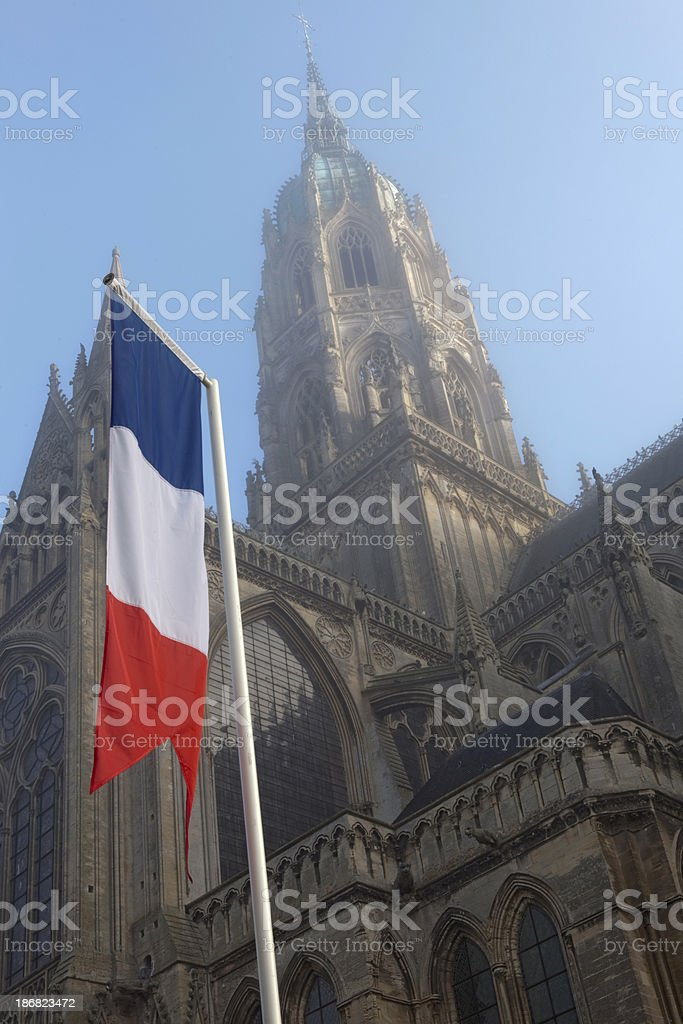 French flag in front of Bayeux' Notre Dame Cathedral stock photo