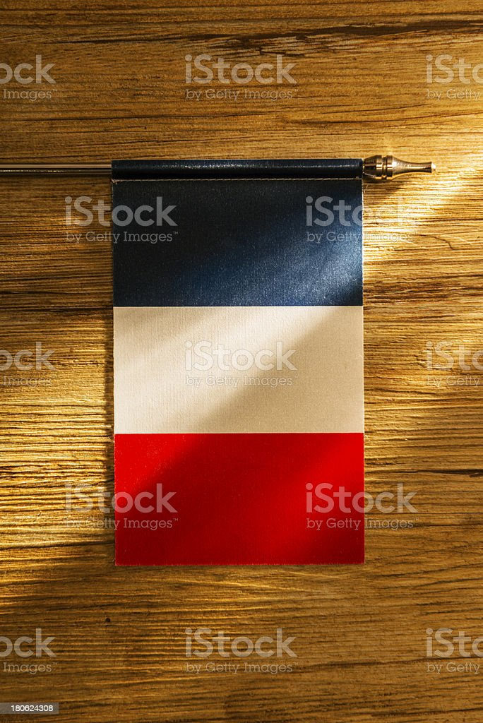 French flag on wooden table royalty-free stock photo