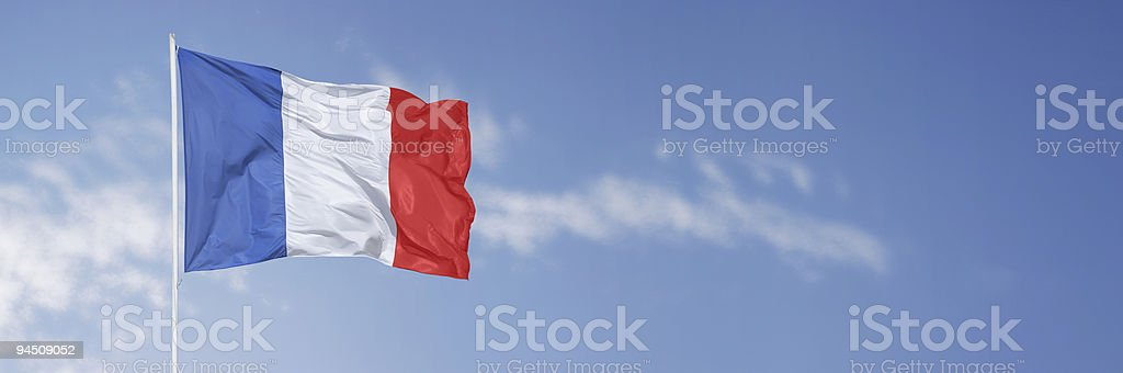 French flag over blue sky stock photo