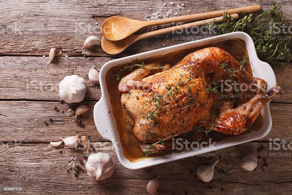French Food: Chicken with 40 cloves of garlic stock photo