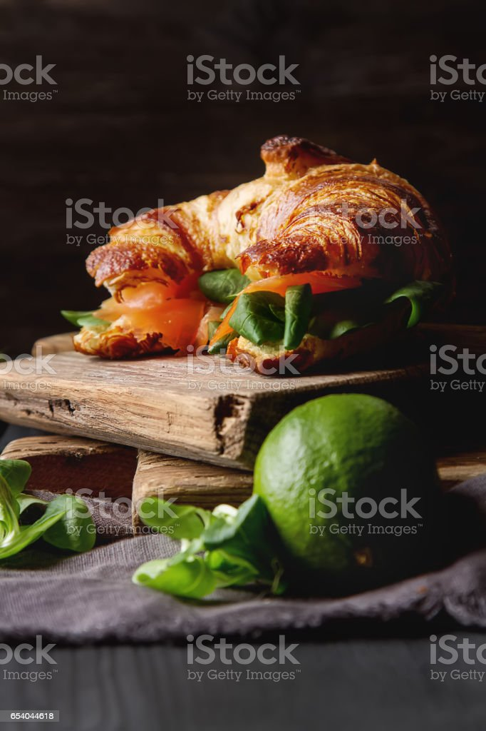 French food for breakfast. Baked Croissant sandwich with salmon stock photo