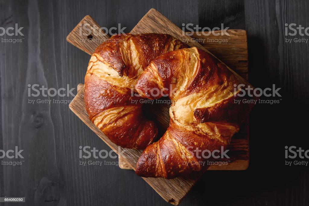 French food for breakfast. Fresh baked croissants. Dark wood bac stock photo