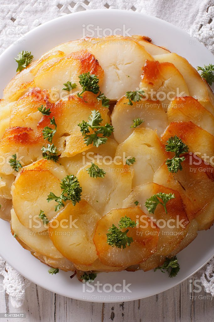 French food: Potato gratin on plate closeup. vertical top view stock photo