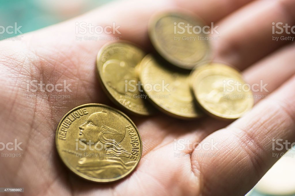French francs in hand stock photo