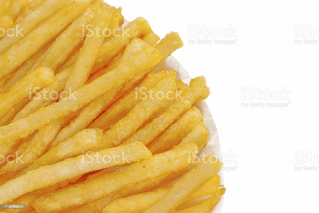 French fried potatoes on a white paper plate royalty-free stock photo