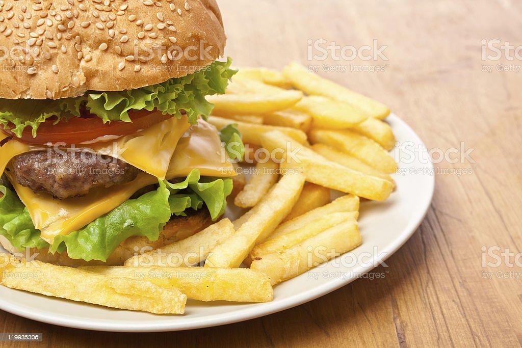 french fries and big cheeseburger royalty-free stock photo