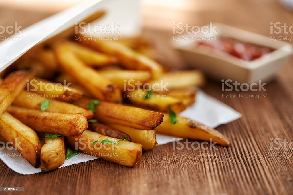 french fries and ketchup stock photo