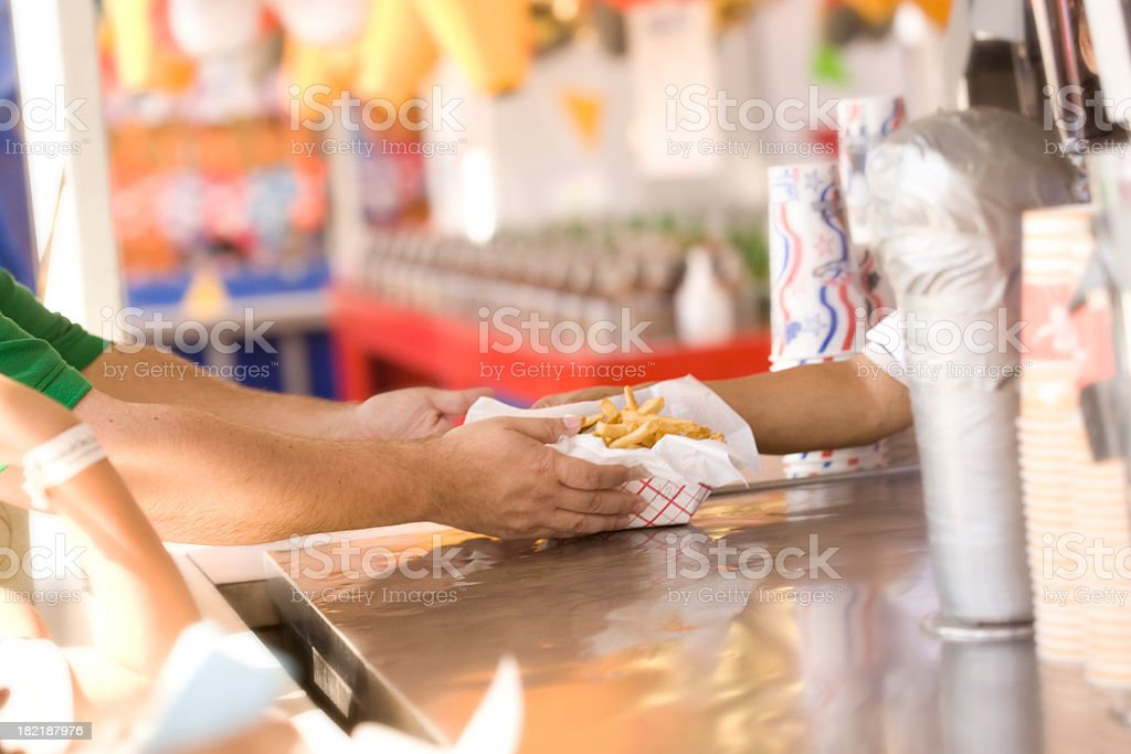French Fries Being Served at the Fair stock photo
