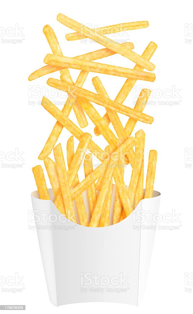 French fries falling into white packaging. Isolated on white royalty-free stock photo
