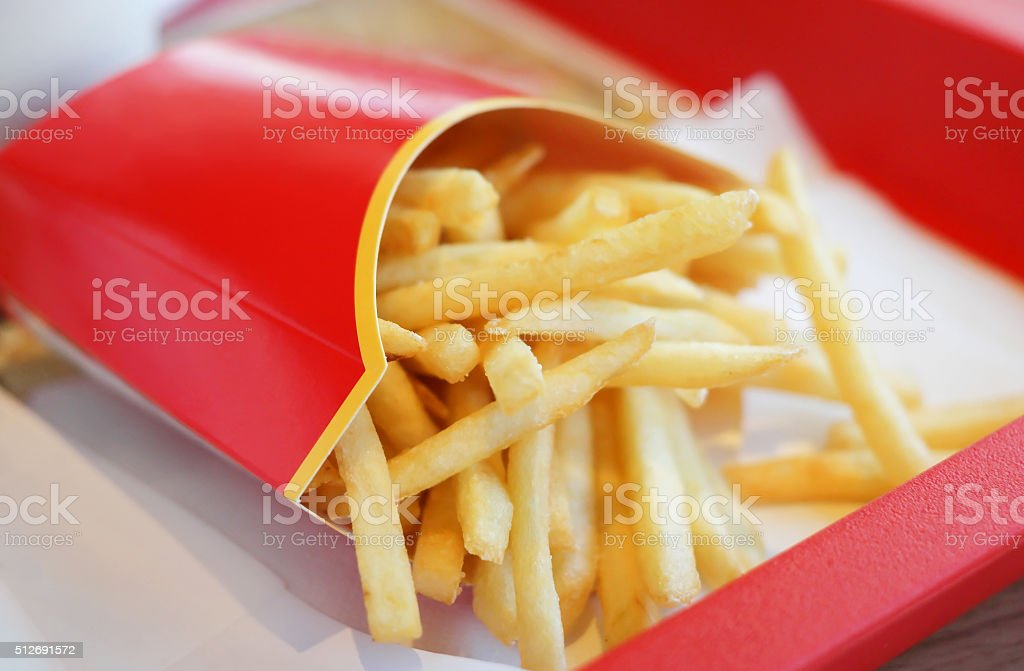 french fries in red carton pack stock photo