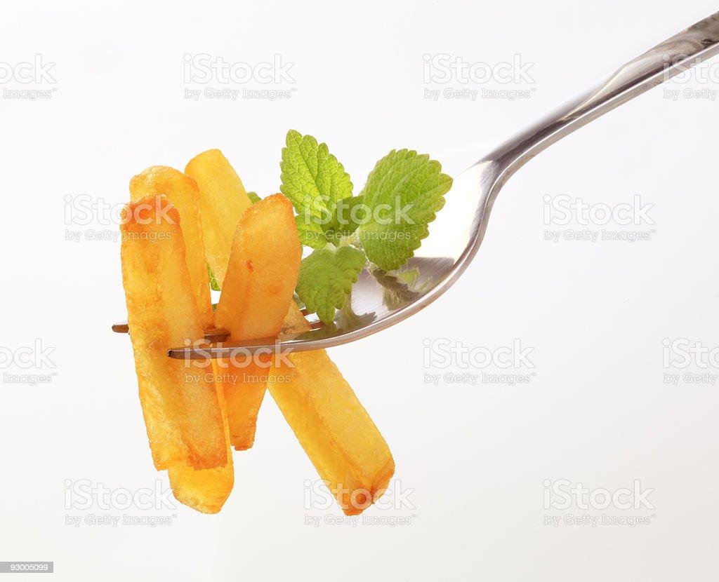 Картофель фри на развилке держитесь правой стороны Стоковые фото Стоковая фотография