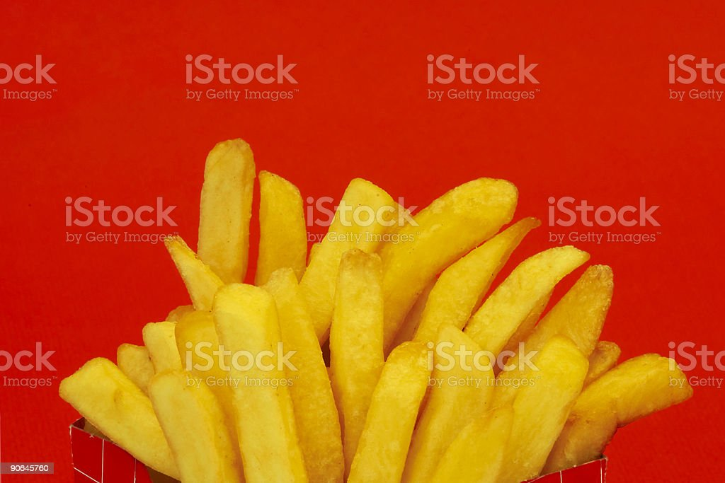 french fries on red 1 royalty-free stock photo