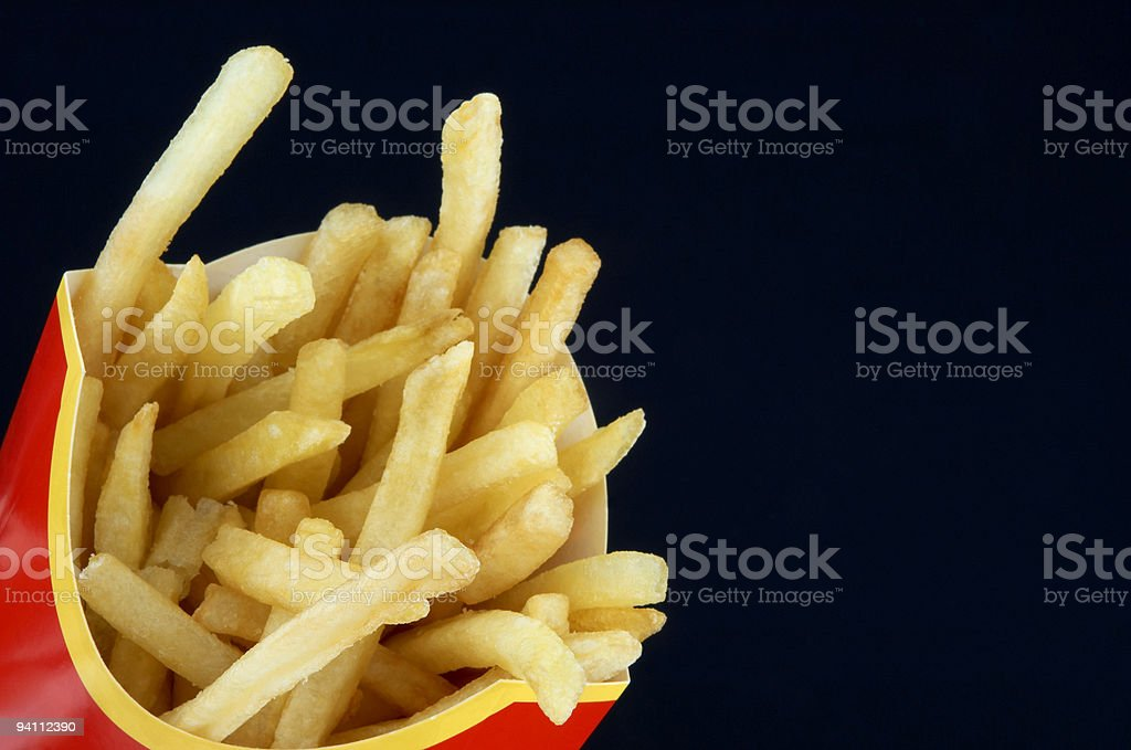 french fries on the black royalty-free stock photo