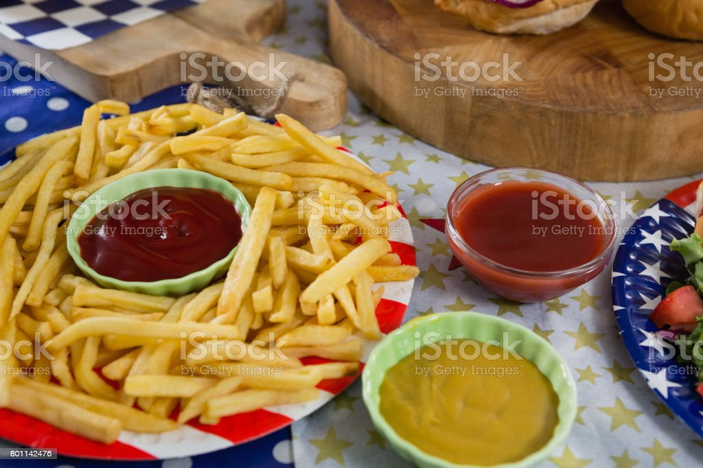French fries on wooden table with 4th july theme stock photo