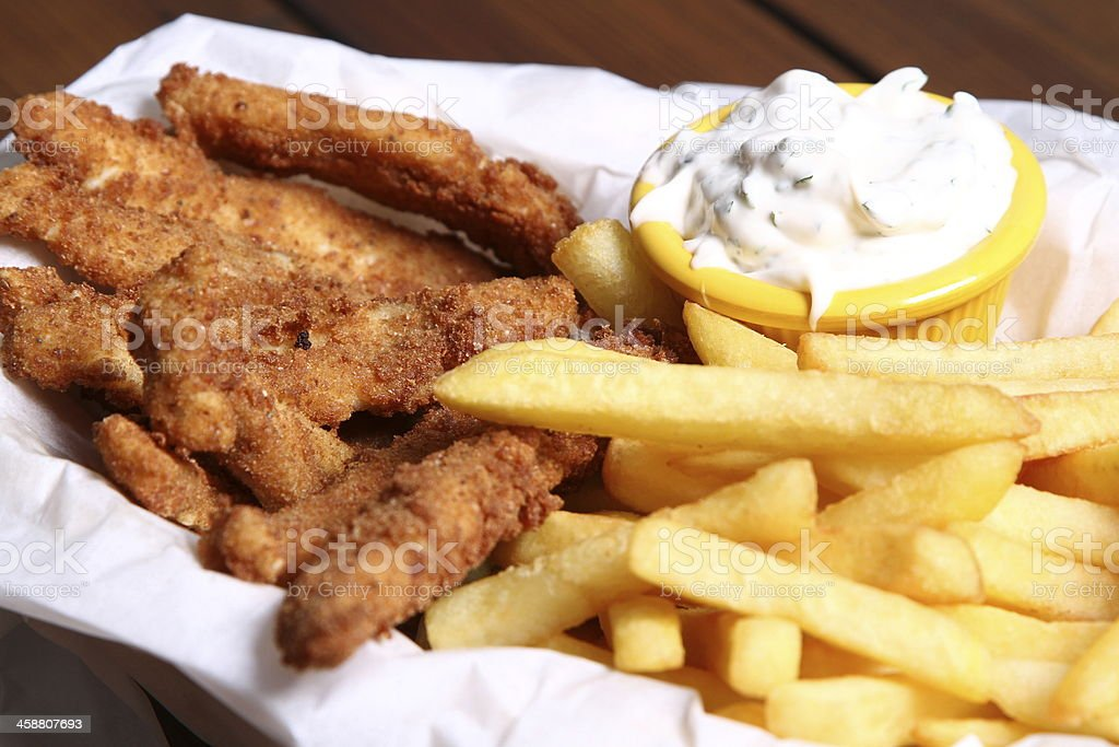 French fries served with chicken strips and tartare sauce stock photo