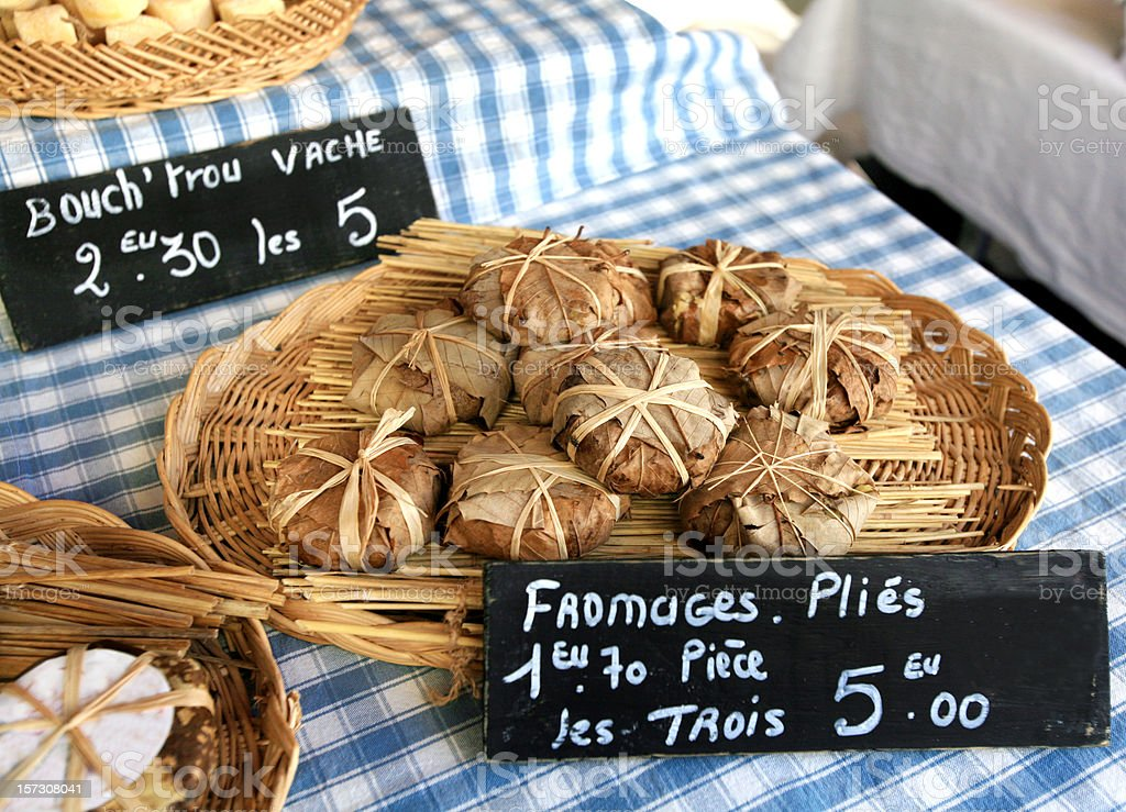 French Goat Cheese at Market Wrapped in Leaves royalty-free stock photo
