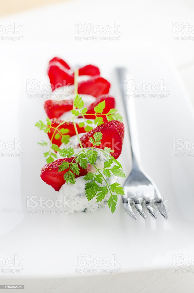 French Goat Cheese with sliced strawberries and chervil royalty-free stock photo