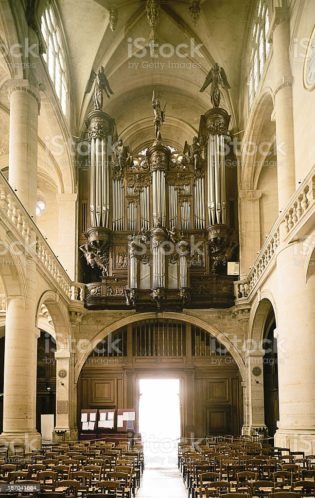 French Gothic Church Nave view with Organ royalty-free stock photo