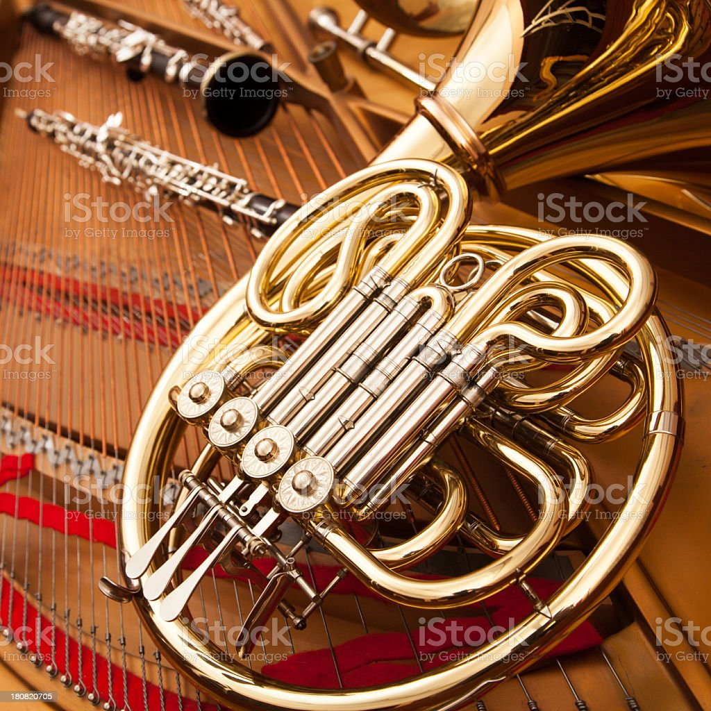 A French Horn and a Clarinet rest on a Harp stock photo