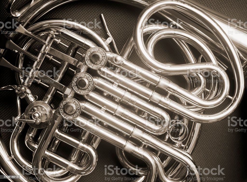 French horn detail sepia toned. stock photo