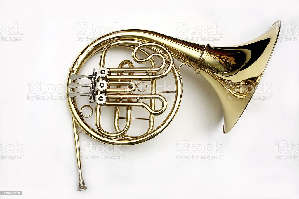 A French horn isolated on a white background stock photo