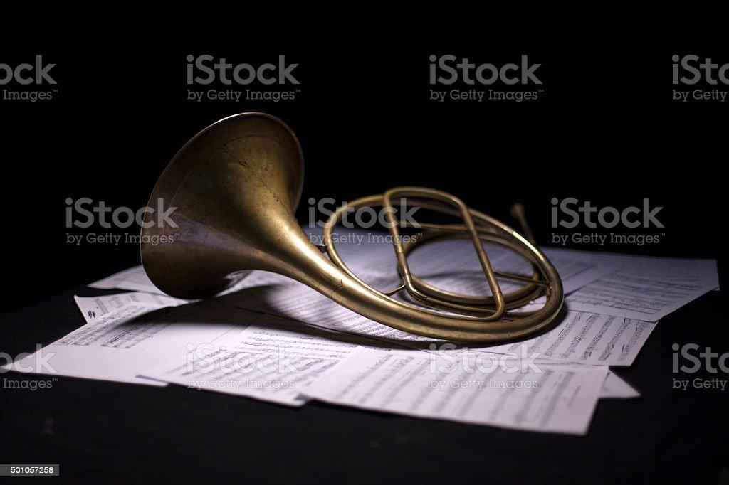French Horn on dark background stock photo