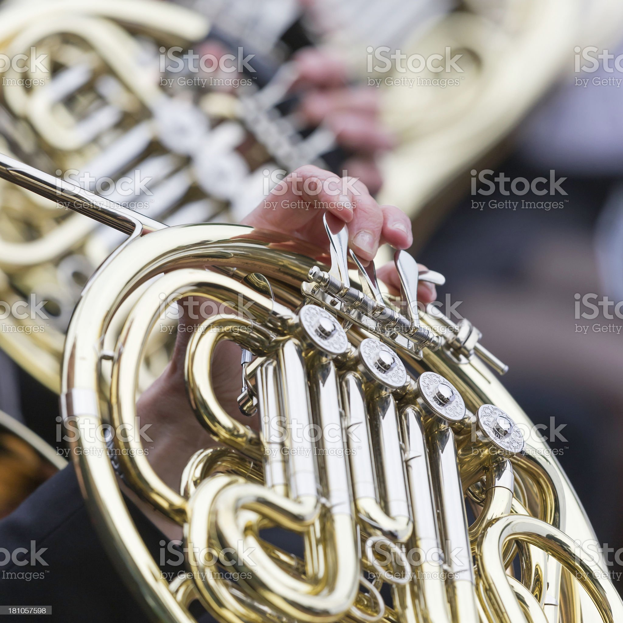 French horn playing in orchestra at outdoor concert, square close-up royalty-free stock photo