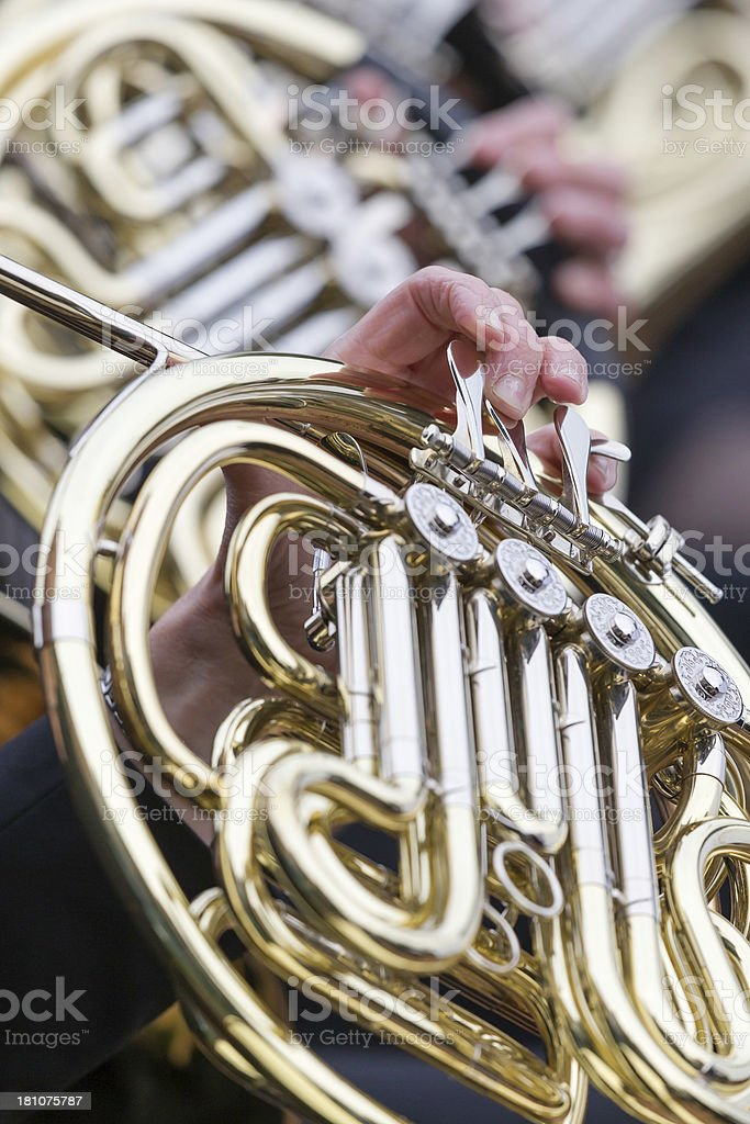French horn playing in orchestra at outdoor concert, vertical close-up royalty-free stock photo