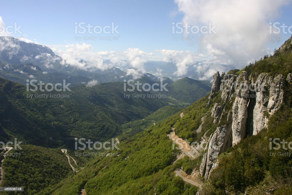 French lower alpine valley with mountains and trees stock photo