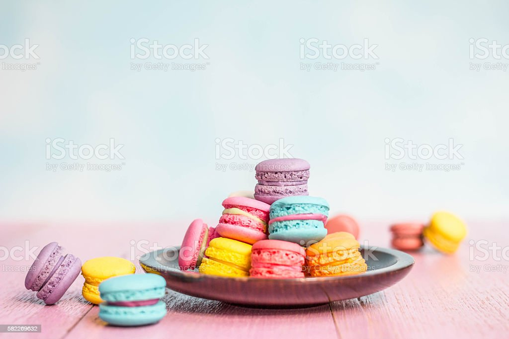 French macarons on pink wooden background. vintage style. stock photo