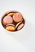 French macarons with chocolate ganache in pastel colors