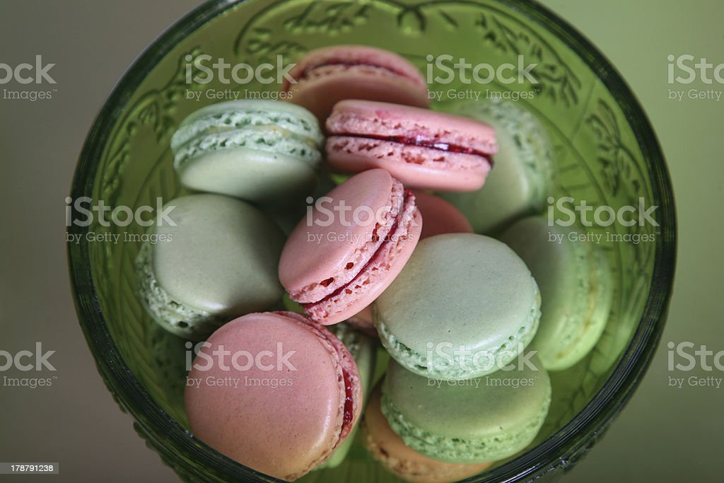 French macaroons on green table in a bowl royalty-free stock photo