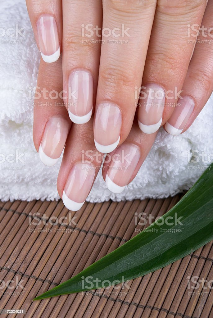French manicured nails with towel and bamboo mat stock photo