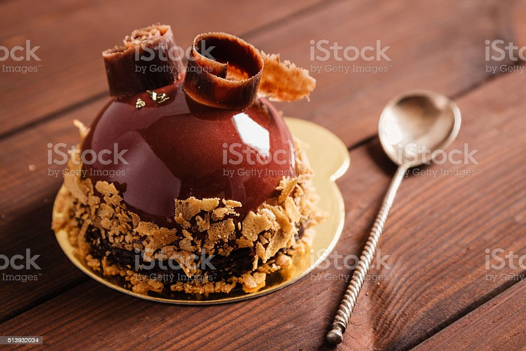 French mousse cake covered with chocolate glaze stock photo