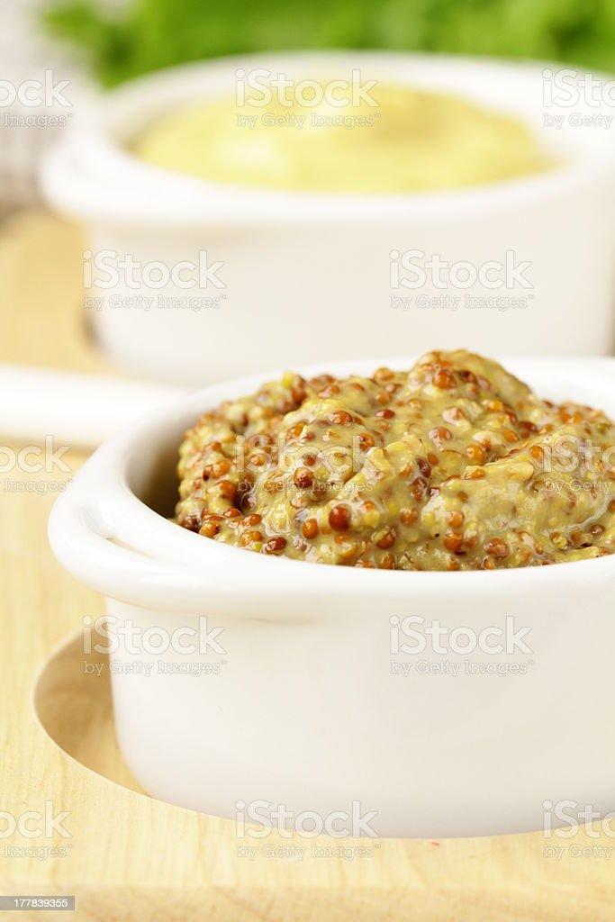 French mustard sauce in white gravy boat stock photo